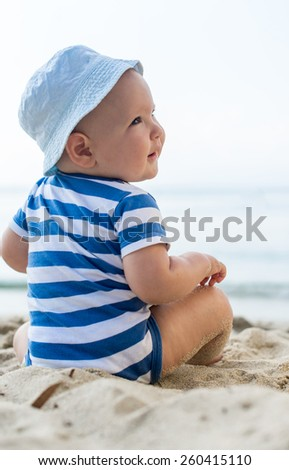 portrait of a caucasian baby boy with a hat - stock photo