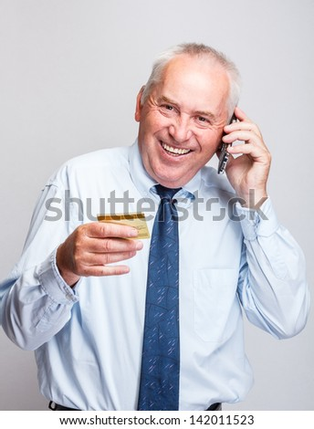 Portrait of a caucasian businessman using a mobile phone