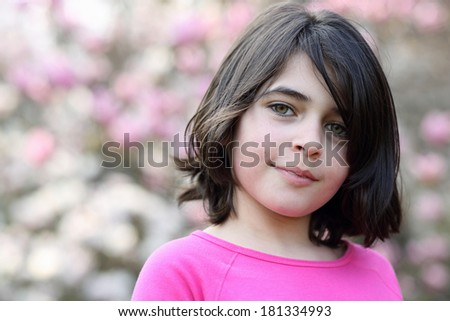 Portrait of a caucasian girl, she is smiling.