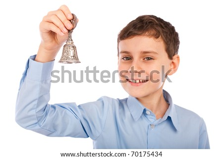 Portrait of a caucasian schoolboy ringing the bell for a course break - stock photo