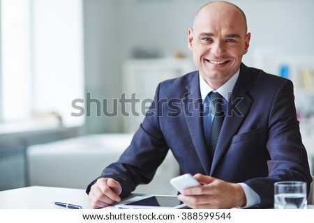 Portrait of a ceo looking at camera and smiling - stock photo