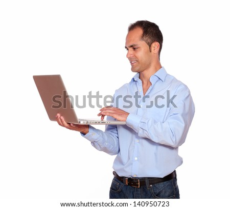 Portrait of a charming adult man working on laptop computer on isolated background