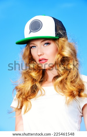 Portrait of a charming girl against the blue sky. - stock photo