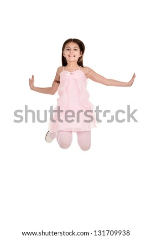 Portrait of a charming little girl in a pink dress on a white background