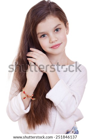 Portrait of a charming little girl smiling at camera, isolated on white background