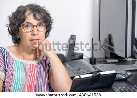 portrait of a charming middle-aged woman in his office - stock photo