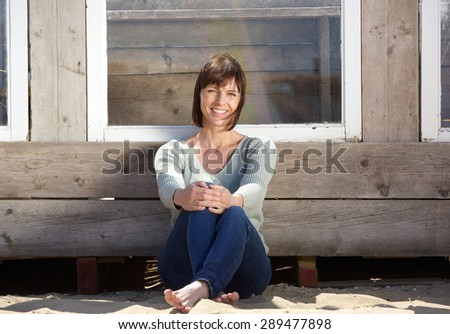 Portrait of a charming older woman sitting outside - stock photo
