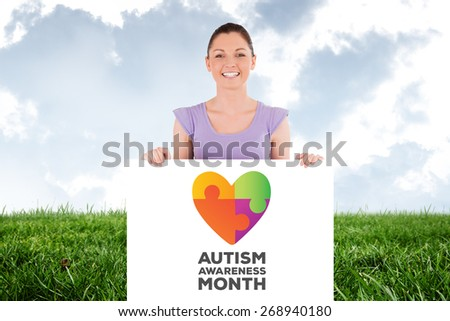 Portrait of a charming woman posing behind a billboard while standing against field and sky - stock photo