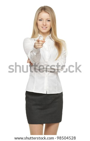 Portrait of a charming young female pointing at you against white background