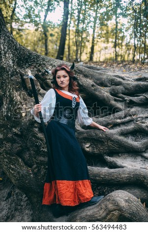 portrait of a charming young red-haired girl Princess with cow's horns. Cow in the magic forest, fantasy, fairy tale, detailed retouch, cosplay of character, gamer's girlfriend
