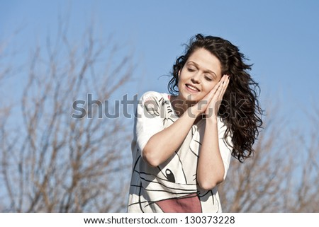 Portrait of a charming young woman dreaming - stock photo