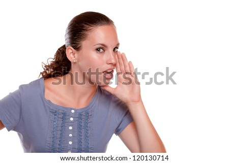 Portrait of a charming young woman whisper at you a secret on isolated background - stock photo