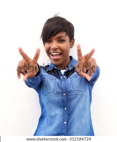 Portrait of a cheerful african american woman with peace hand sign - stock photo