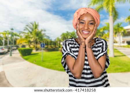 Portrait of a cheerful african woman - stock photo