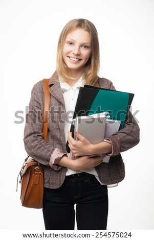 Portrait of a cheerful attractive young student woman with a bag holding books. - stock photo