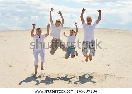 portrait of a cheerful boys with his grandparents for a walk - stock photo