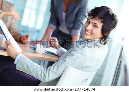 Portrait of a cheerful business girl distracted in the process of discussion - stock photo