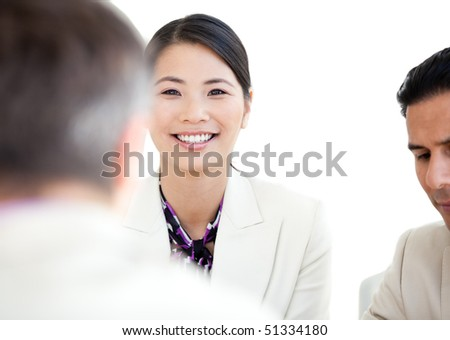 Portrait of a cheerful businesswoman in a meeting - stock photo