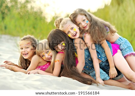 portrait of a cheerful child on the beach - stock photo