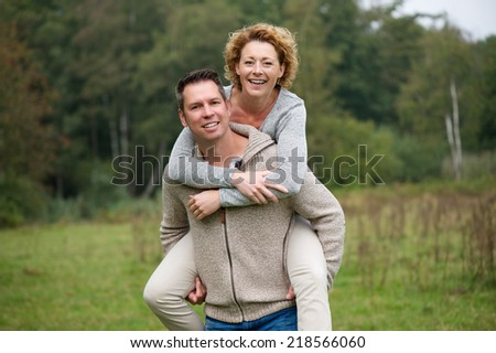 Portrait of a cheerful couple enjoying life outdoors