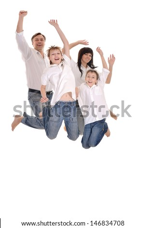 portrait of a cheerful family of four people jumping on a white background - stock photo