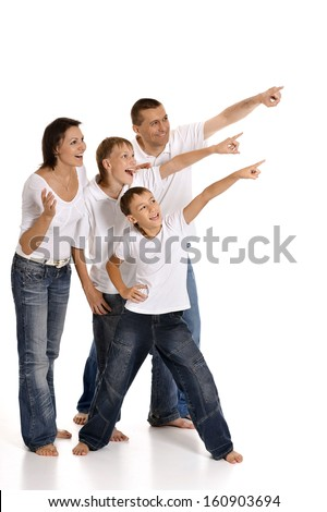 Portrait of a cheerful family of four people pointing on a white background