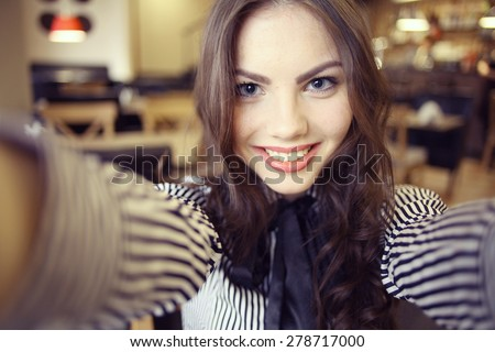 Portrait of a cheerful girl - stock photo
