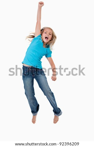 Portrait of a cheerful girl jumping against a white background - stock photo