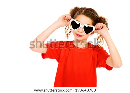 Portrait of a cheerful girl wearing party sunglasses smiling at camera. Isolated over white. - stock photo