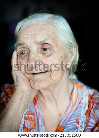 Portrait of a cheerful grandmother eighty-seven years - stock photo