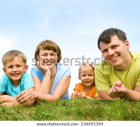 Portrait of a cheerful great families with their children outdoor. Seven - stock photo