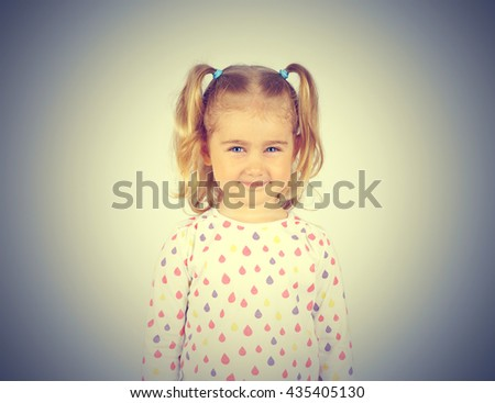 Portrait of a cheerful little girl. Child, preschool education.     - stock photo