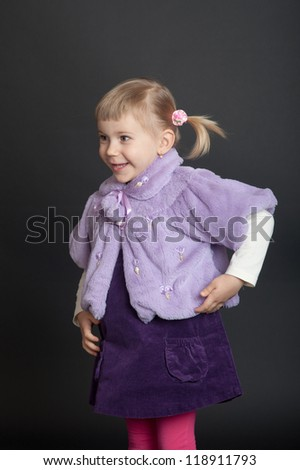 portrait of a cheerful little girl on a black background