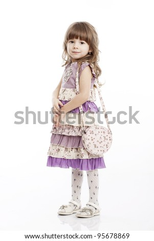 Portrait of a cheerful little girl with a bag