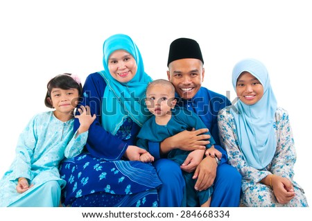 Portrait of a cheerful malay family - stock photo