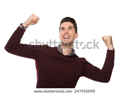 Portrait of a cheerful man celebrating with arms raised on isolated white background - stock photo