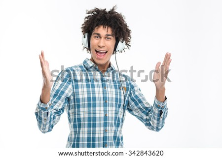 Portrait of a cheerful man in headphones looking at camera isolated on a white background - stock photo