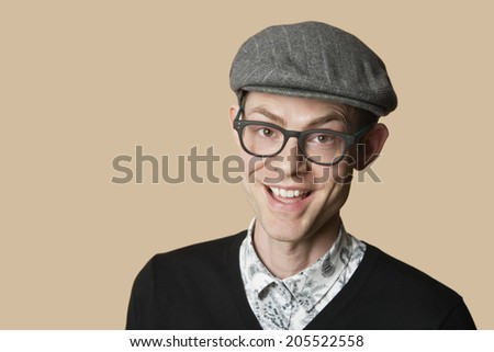 Portrait of a cheerful mid adult man wearing retro glasses over colored background - stock photo