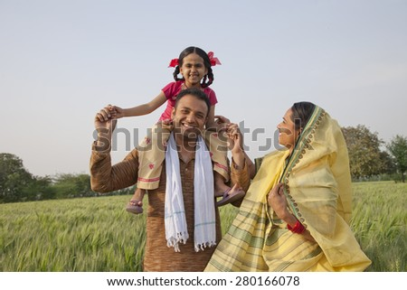 Portrait of a cheerful rural family in the field - stock photo