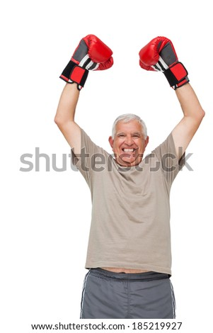Portrait of a cheerful senior boxer standing over white background