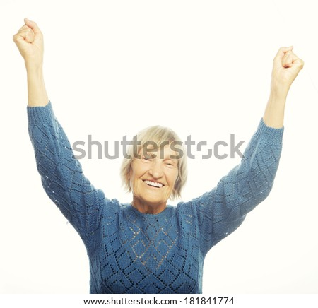 portrait of a cheerful senior woman gesturing victory over a white background  - stock photo