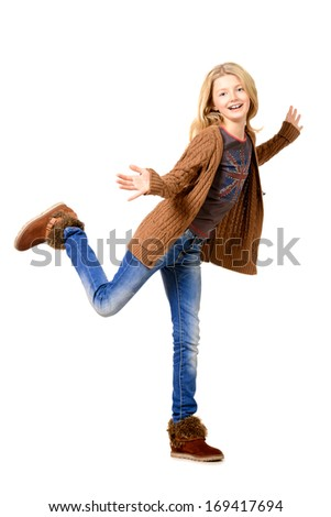 Portrait of a cheerful ten years girl jumping for joy. Isolated over white. - stock photo