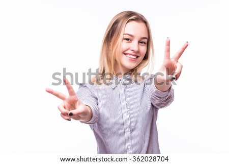 Portrait of a cheerful woman showing two fingers sign isolated on a white background - stock photo