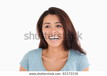 Portrait of a cheerful woman standing against a white background