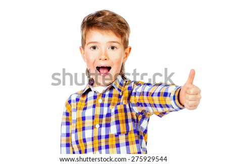 Portrait of a cheerful 7 year old boy showing thumb. Copy space. Isolated over white. - stock photo