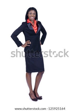 Portrait of a cheerful young African American businesswoman with hand on hips - stock photo