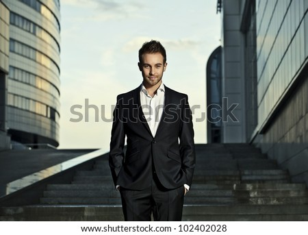 Portrait of a cheerful young businessman - stock photo