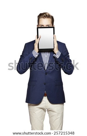 Portrait of a cheerful young businessman holding a blank digital tablet. - stock photo