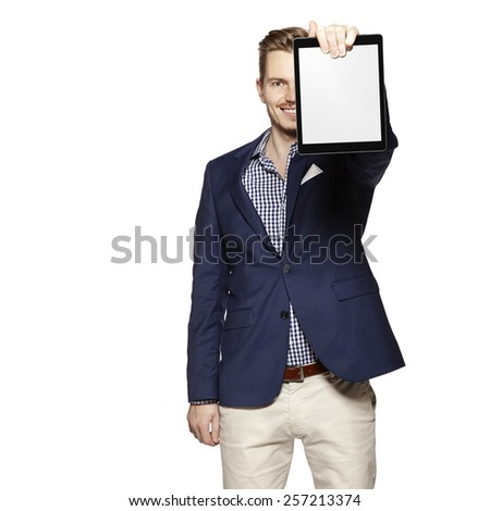 Portrait of a cheerful young businessman holding a blank digital tablet. Copy space. - stock photo