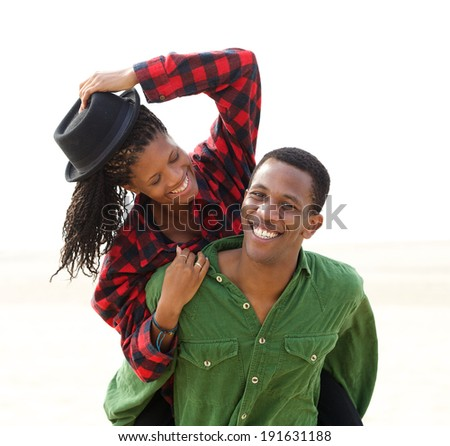 Portrait of a cheerful young couple smiling together outdoors  - stock photo